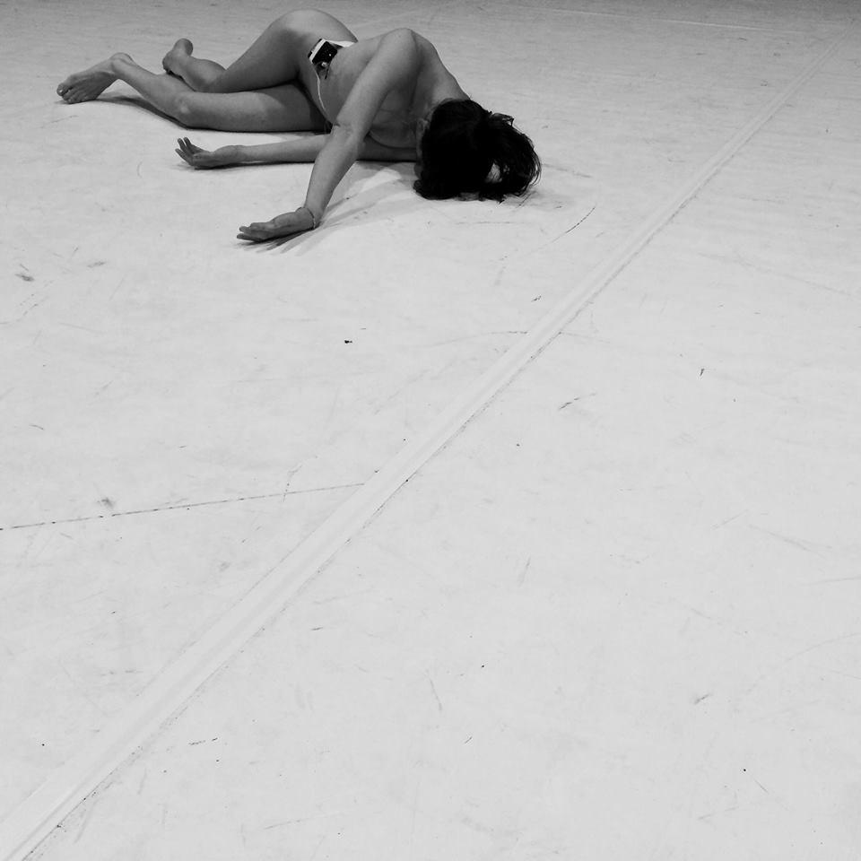 Dancer lying on floor